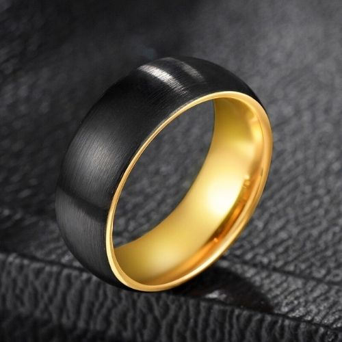 Sleek black and gold ring for men