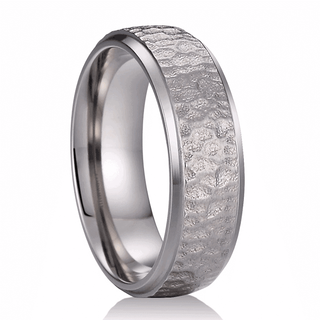 A silver titanium ring with a hammered finish