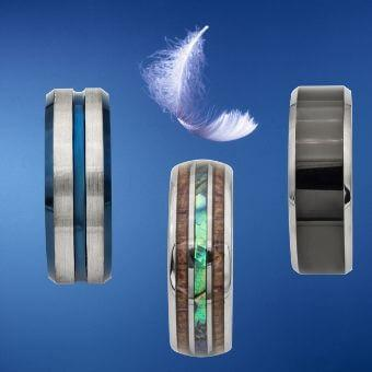 3 titanium men's rings with feather floating above