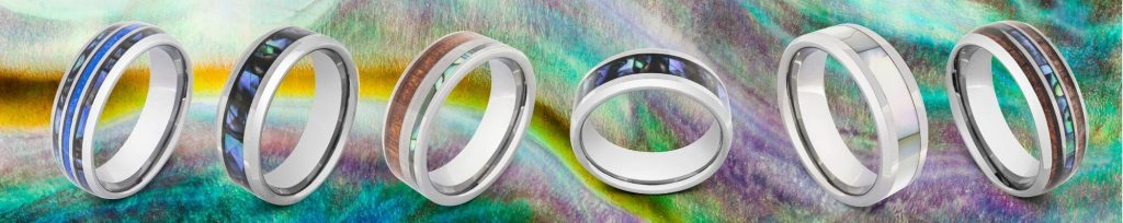 Selection of rings designed for men featuring abalone shell