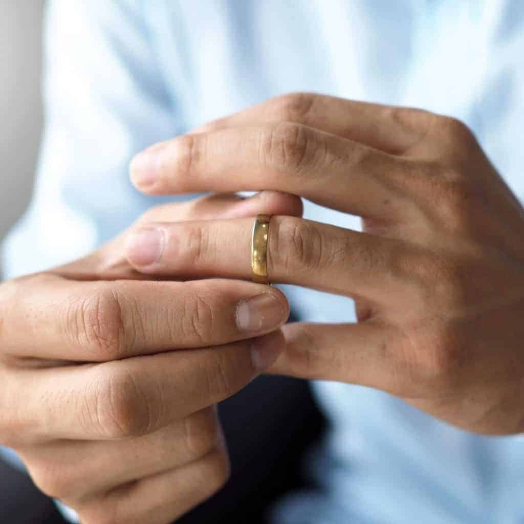 Man tries on his wedding ring