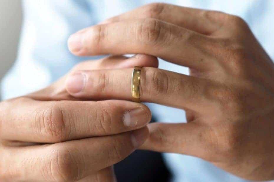 Man tries on his wedding ring