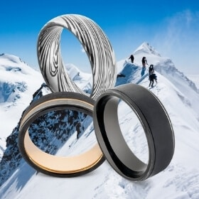 3 Black Rings for Men against Snowy Mountain Background