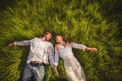 Couple relax on the grass together