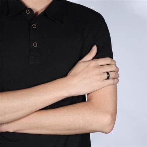 Man wearing black titanium ring