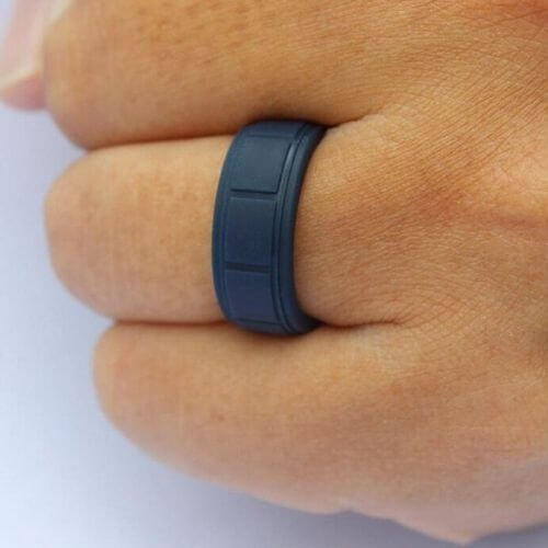 Man wears navy blue silicone ring