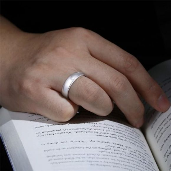 Man wearing silver tungsten ring for men