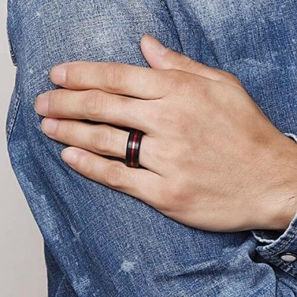 Man wearing his black and red ring