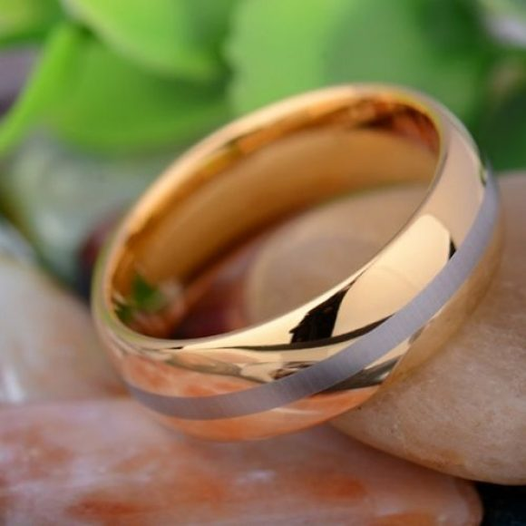 Gleaming men's gold ring with silver stripe