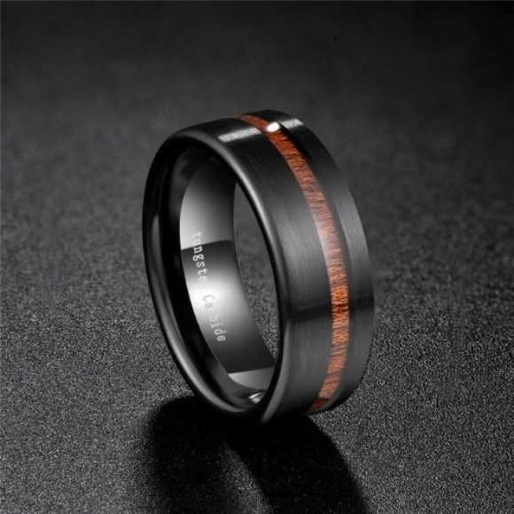Strong men's ring made with tungsten carbide and wood