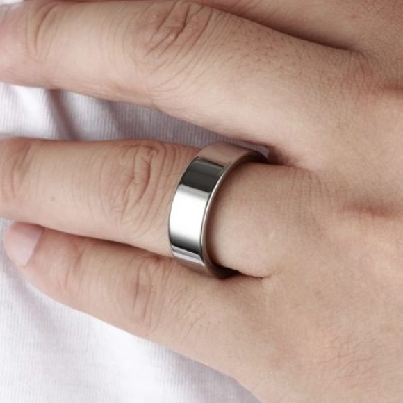 Man tries on his silver tungsten ring